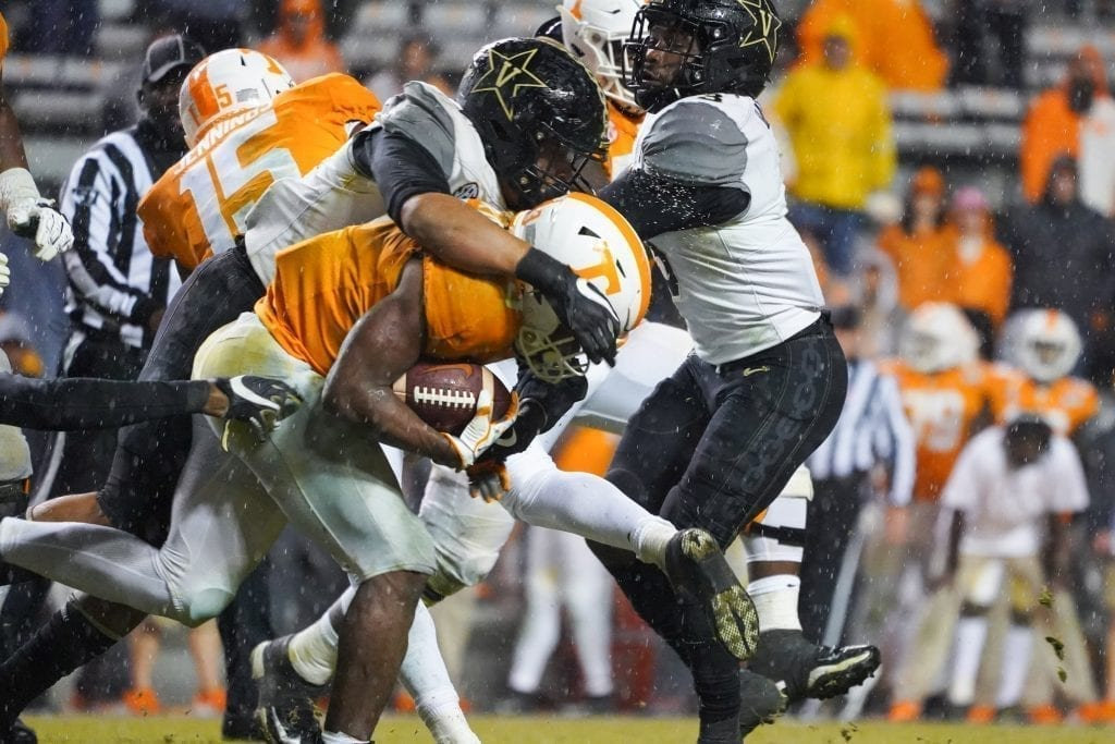 Tennessee running back Eric Gray (3) gets tackled by Vanderbilt defenders when Tennessee played Vanderbilt on Nov. 30, 2019. Photo/ Ben Gleason
