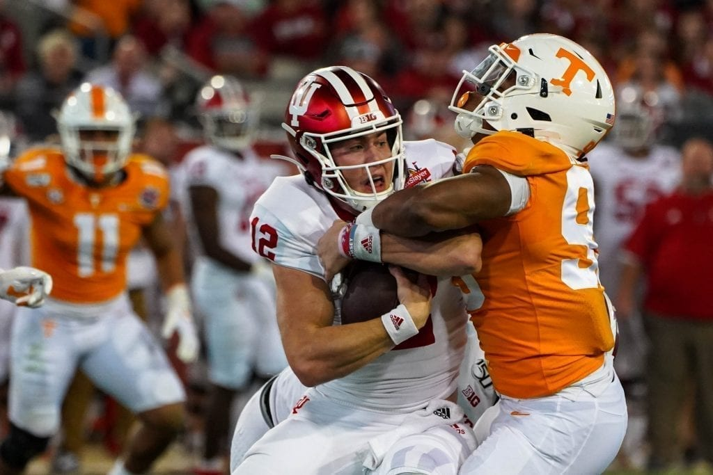 Tennessee linebacker Kivon Bennett (95) wraps up an Indiana ball carrier when Tennessee played Indiana in the Tax Slayer Gator Bowl on Jan. 1, 2020. Photo/ Ben Gleason