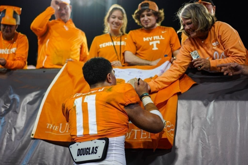 Tennessee linebacker Henry To'o To'o (11) signs an autograph after the game when Tennessee played Indiana in the Tax Slayer Gator Bowl on Jan. 1, 2020. Photo/ Ben Gleason