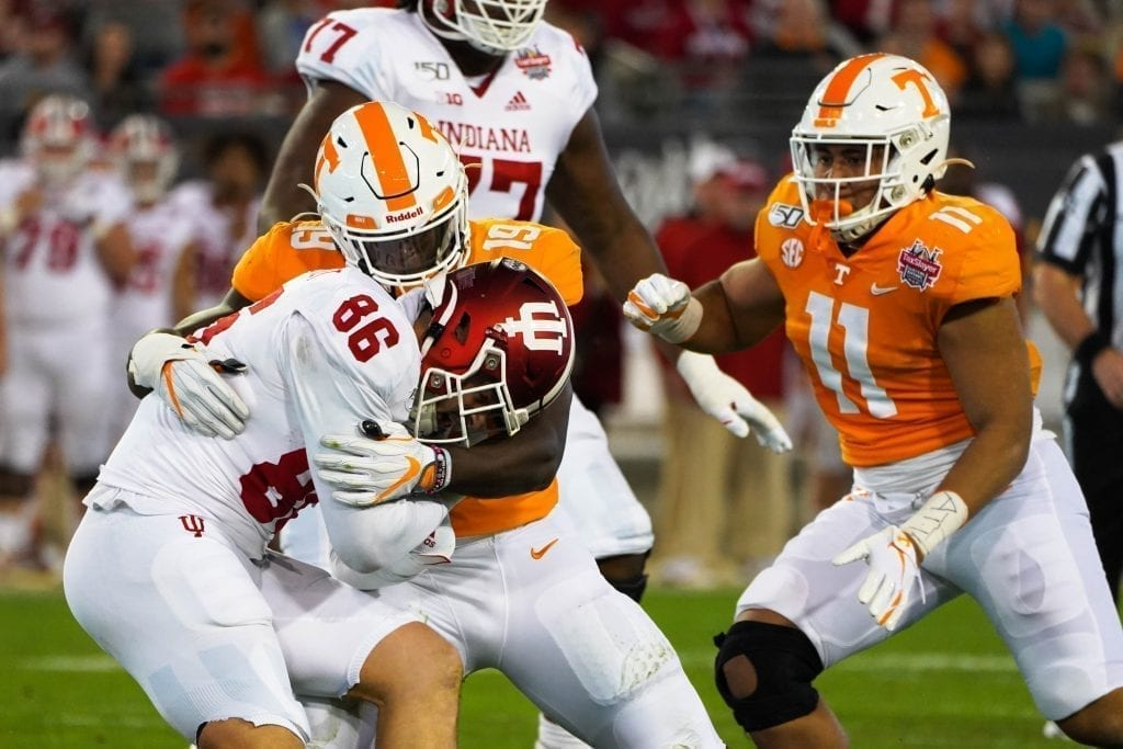 Tennessee linebacker Darrell Taylor (19) wraps up an Indiana ball carrier when Tennessee played Indiana in the Tax Slayer Gator Bowl on Jan. 1, 2020. Photo/ Ben Gleason