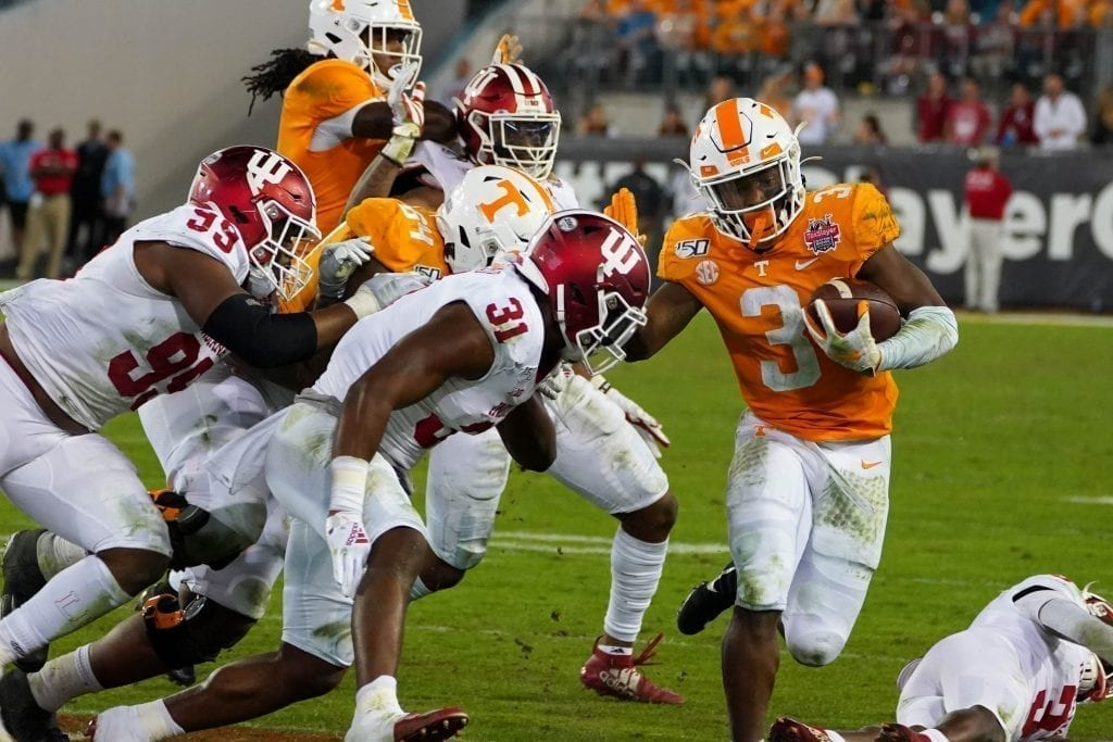 Tennessee running back Eric Gray runs amongst Indiana defenders when Tennessee played Indiana in the Tax Slayer Gator Bowl on Jan. 1, 2020. Photo/ Ben Gleason