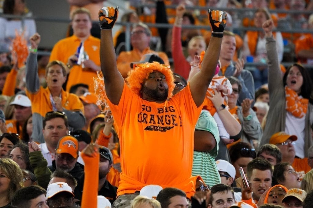 A Tennessee fan cheers during the game when Tennessee played Indiana in the Tax Slayer Gator Bowl on Jan. 1, 2020. Photo/ Ben Gleason