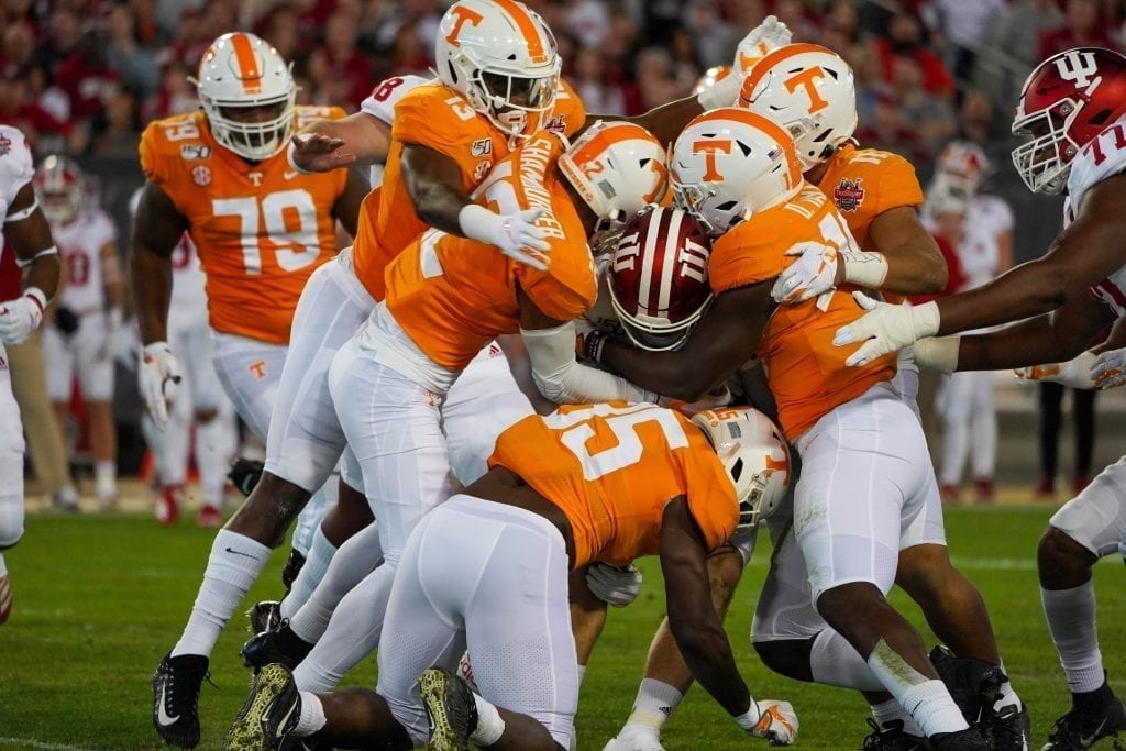 Tennessee defenders gang tackle an Indiana ball carrier when Tennessee played Indiana in the Tax Slayer Gator Bowl on Jan. 1, 2020. Photo/ Ben Gleason
