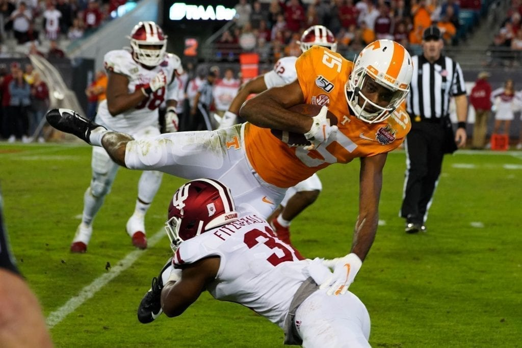 Tennessee wide receiver Jauan Jennings (15) is tackled by an Indiana defender when Tennessee played Indiana in the Tax Slayer Gator Bowl on Jan. 1, 2020. Photo/ Ben Gleason