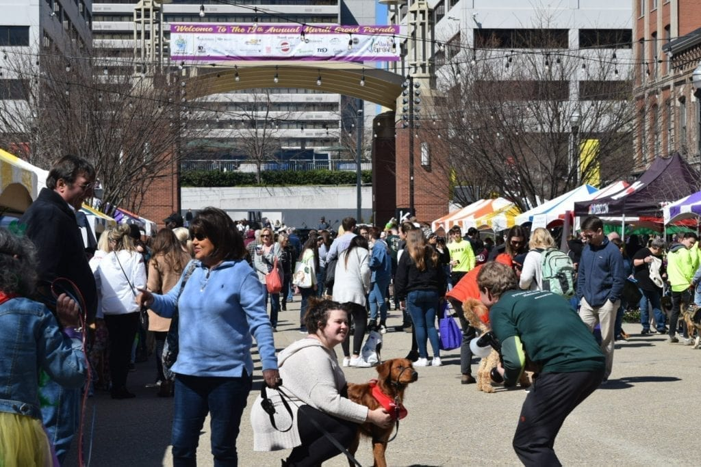 The streets of Market Square are full with two-legged and four-legged friends enjoying vendor's booths, food trucks, music and more at the Mardi Growl in Knoxville, Tennessee on March 7, 2020. Photo/Amber Scruggs